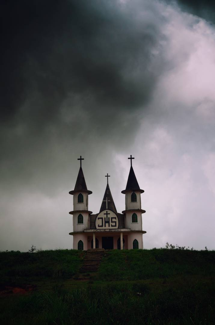 A church against a moody sky I stopped to photograph in Pynursla on the way to Cherrapunjee