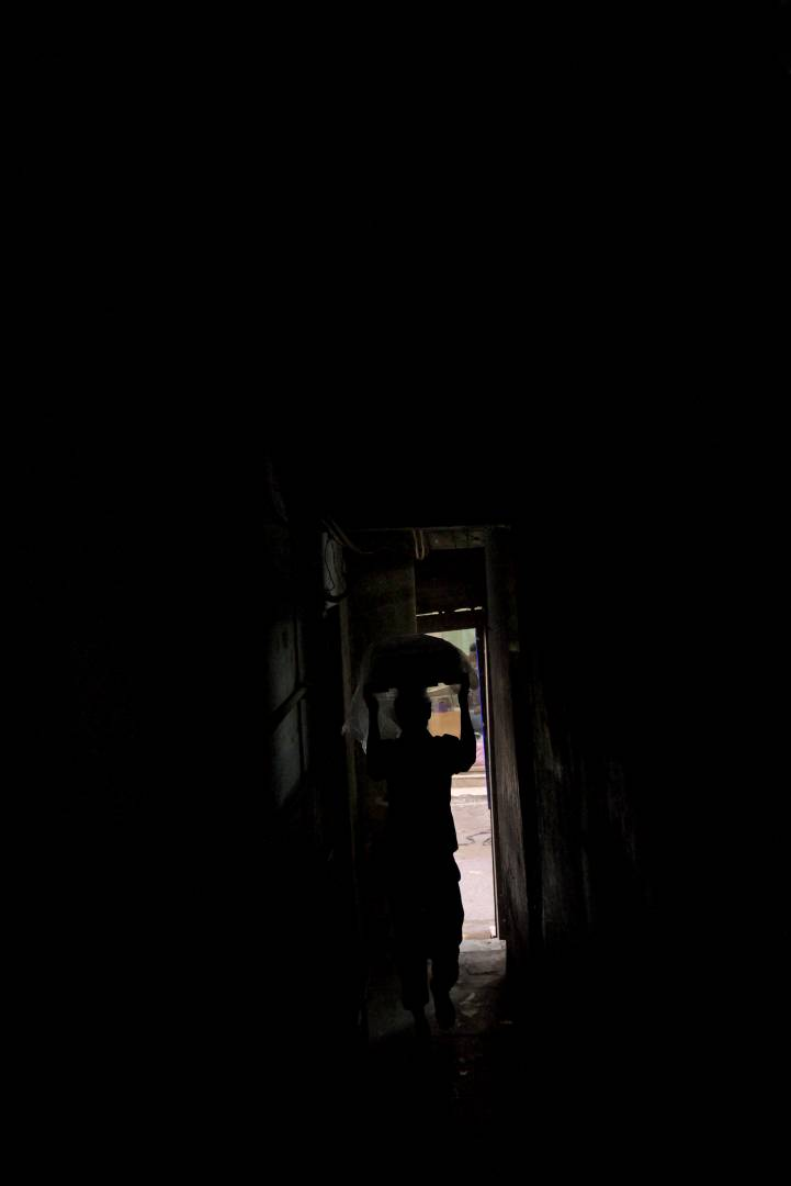 The alleyway to Jain Coffee House in Raghu Ganj, Chawri Bazar is a dark narrow passage just wide enough for one person to pass at a time. The coffee house is famous for its fruit sandwiches. I remember it was so dark in that corridor I was fortunate to get some form of the man with the bundle on his head.