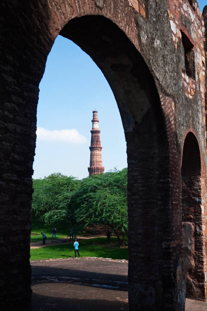 A game of cricket and the Qutab Minar seen from the Archaeological Park where according to some historians there is more history per square inch than anywhere else in the world.