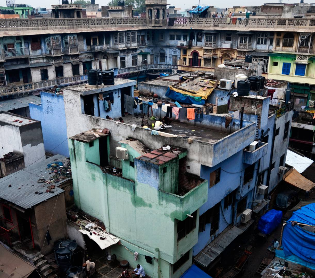 Khari Baoli in Old Delhi, meaning salt water step well, is Asia's largest spice market. This view of the surroundings is from the terrace of Gadodia Market. The day starts with the morning washing for these residents.