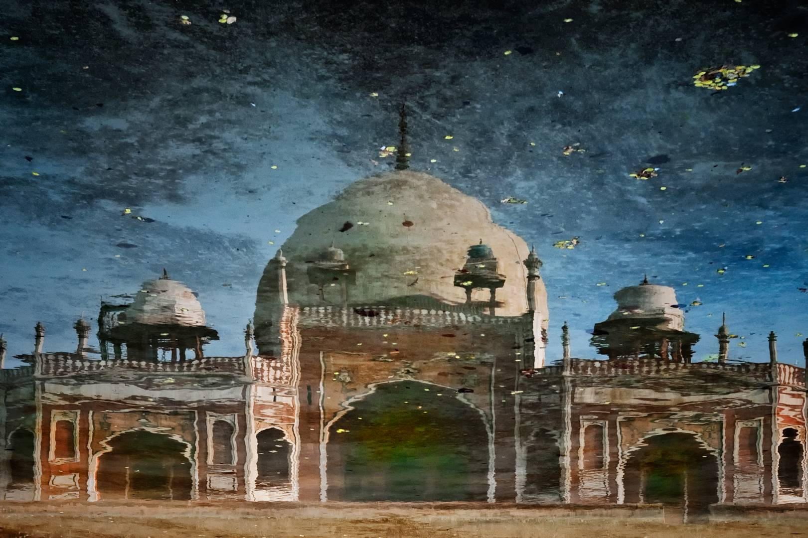 Humayun's Tomb in Nizamuddin reflected in a pool before its magnificent restoration.