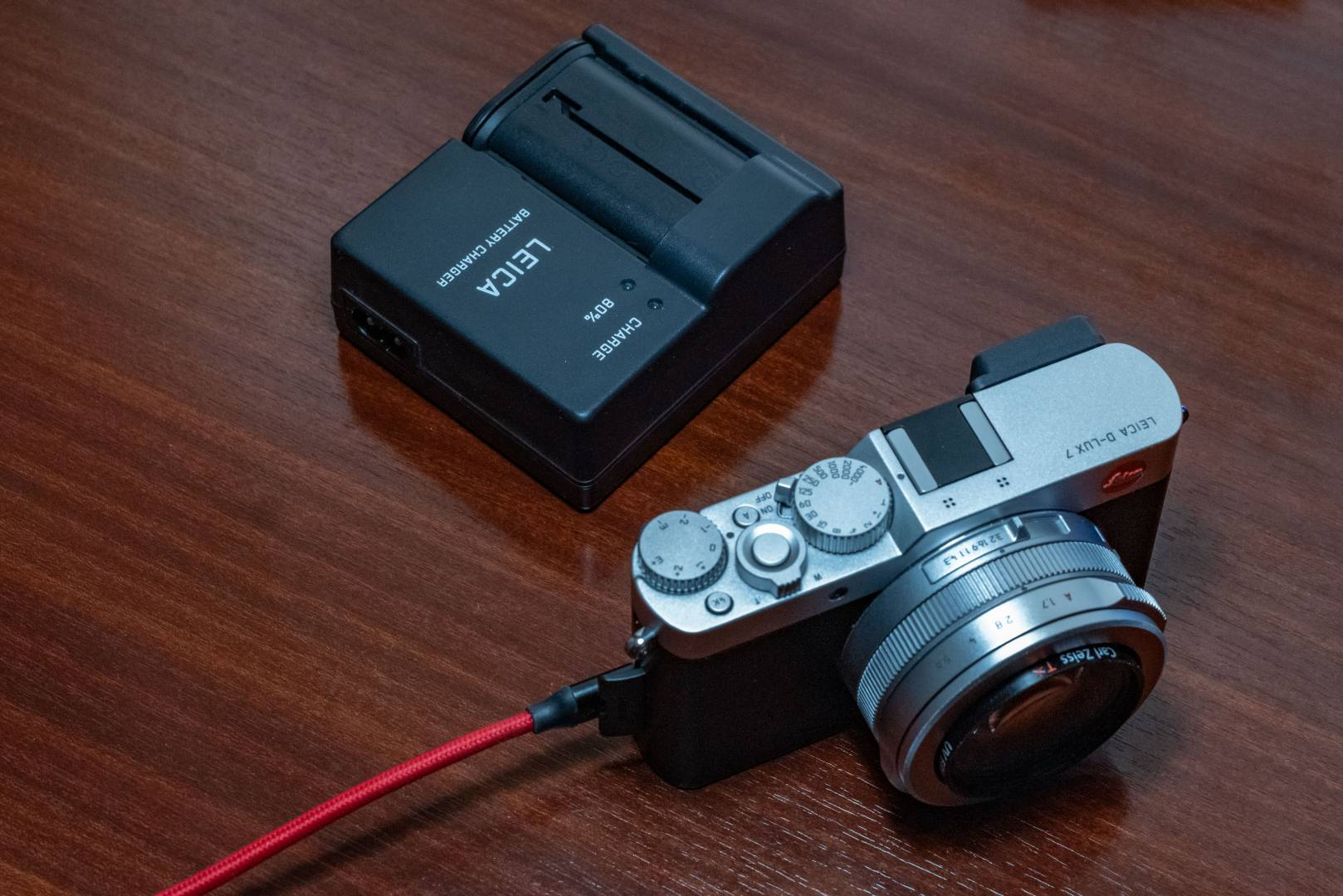 Leica's D-Lux 7 (here) and C-Lux also offer USB charging but, in this case, using the micro-USB interface. Above the camera you see the hefty charger and battery for the SL, SL2, Q and Q2. Forget to pack it at your peril because of those cameras only the SL2 is a safe bet.