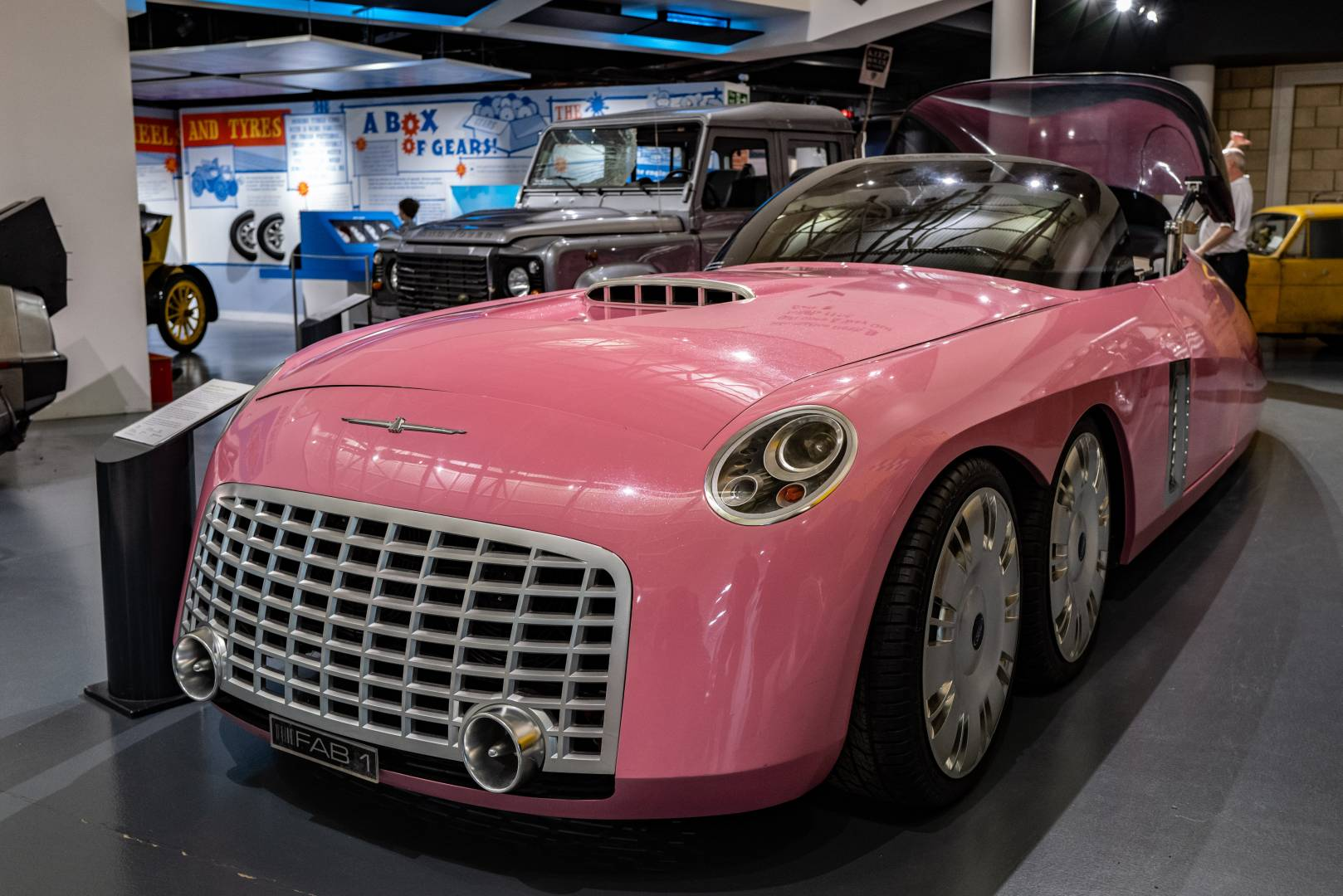 Lady Penelope's FAB 1 car from the 1960s television series Thunderbirds. Below, a futuristic cockpit for Parker the chauffeur. This car was built by Ford and based on the then Ford Thunderbird.