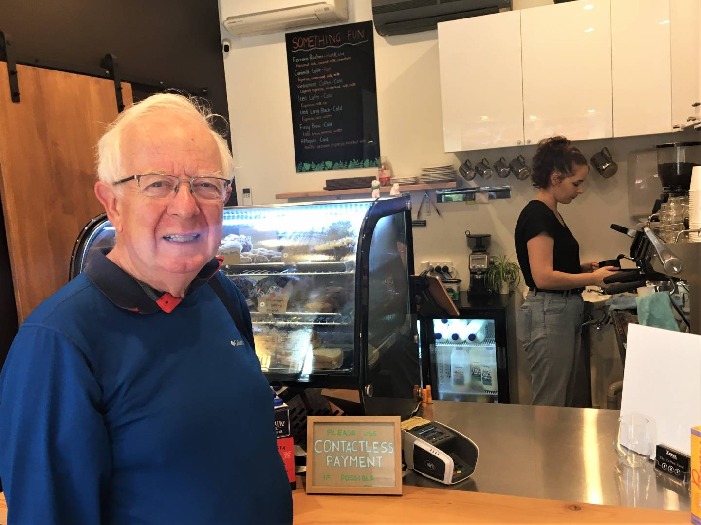 """But we did succeed in getting coffee at a different cafe. Good coffee too, and John was so appreciative that he would have liked to hug the attractive barista. That is, until he saw the """"Contactless Payment"""" directive on the counter."""