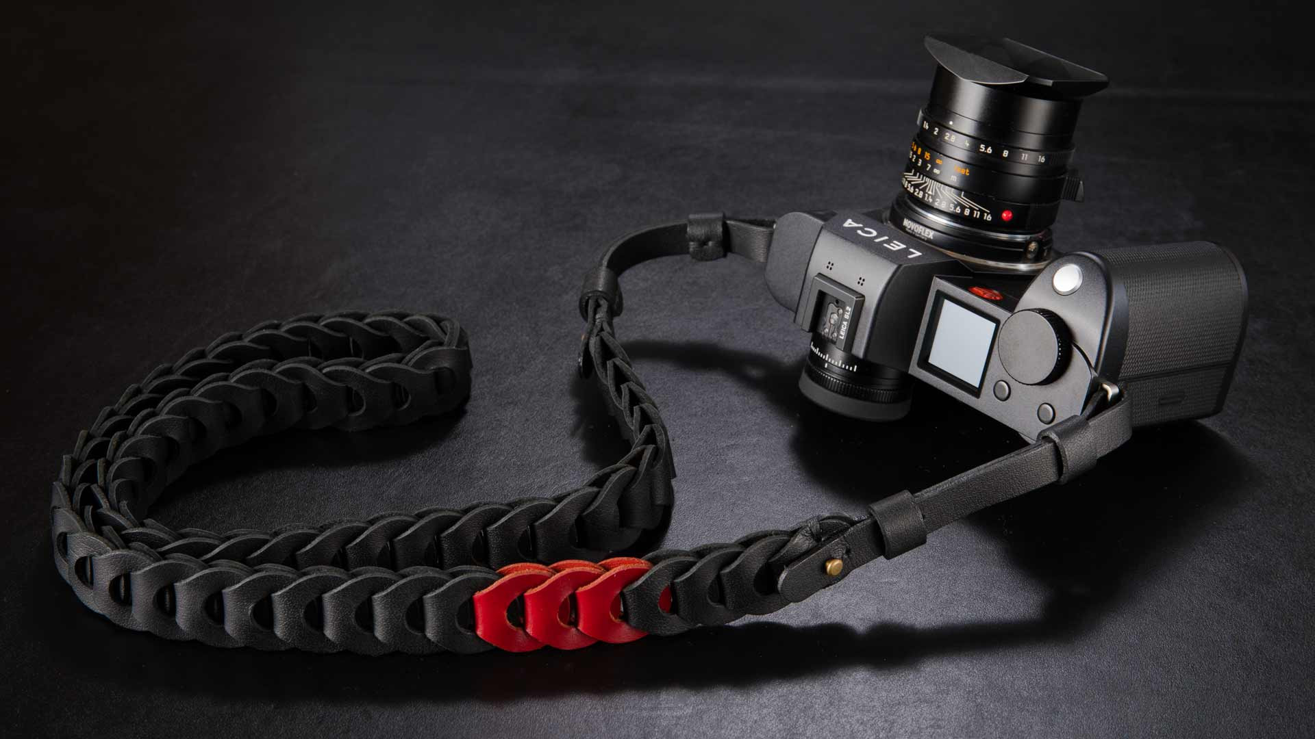 The Limited Edition in black with three red links is R&R's classic design for Leica
