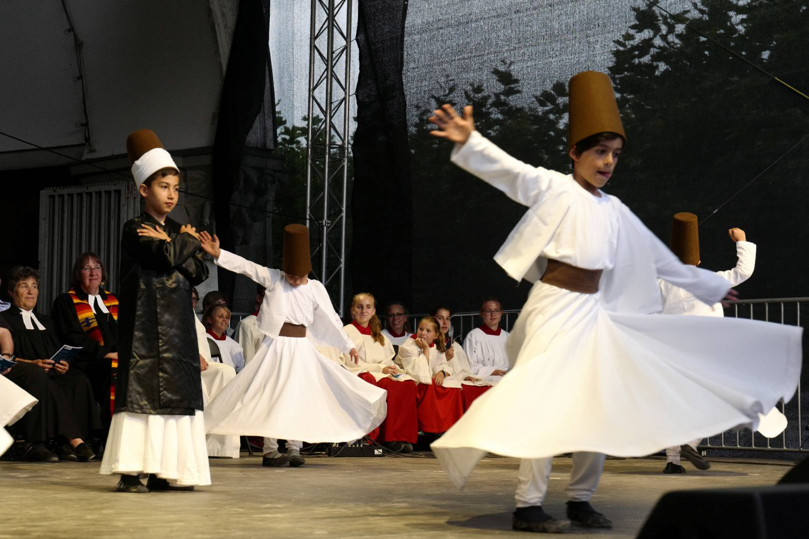 A multi-faith festival in Konstanz. Young boys froth the Turksih community perform a Dervish dance in front of the representatives of the Christian Churches. (Leica SL Vario-Elmarit SL 24-90; 69 mm; 1/125 sec. f/5.6; ISO 2500)