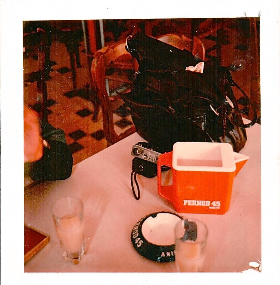 Paris café: notice the silvery bottom of the little camera to the left of the red Pernod water jug? That'll appear later as camera number 5.