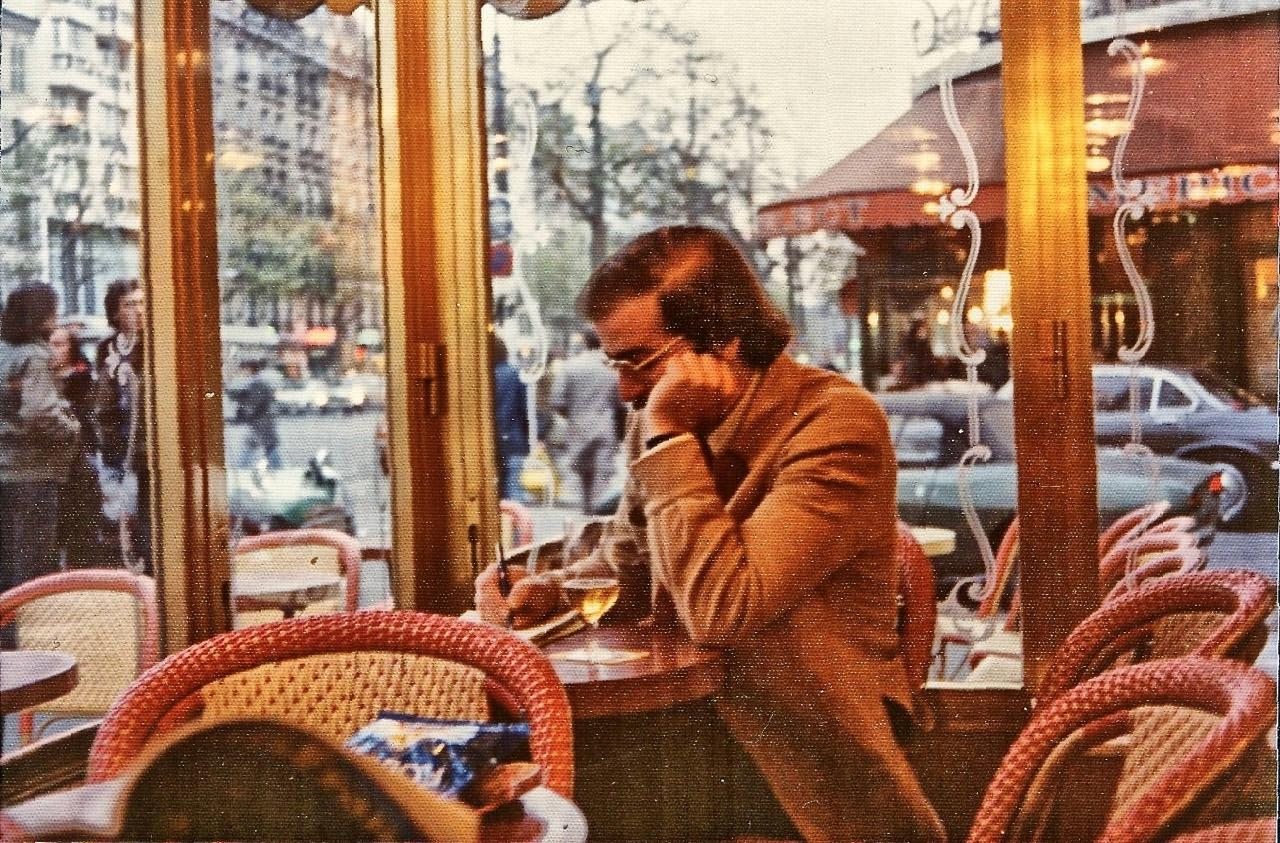 A writer in a bar, Montparnasse, Paris. The peculiar texture to this photo is the then-popular knobbly 'matte' print surface, instead of glossy. (This is an old print which I've scanned; I don't think I have the negative any more.)