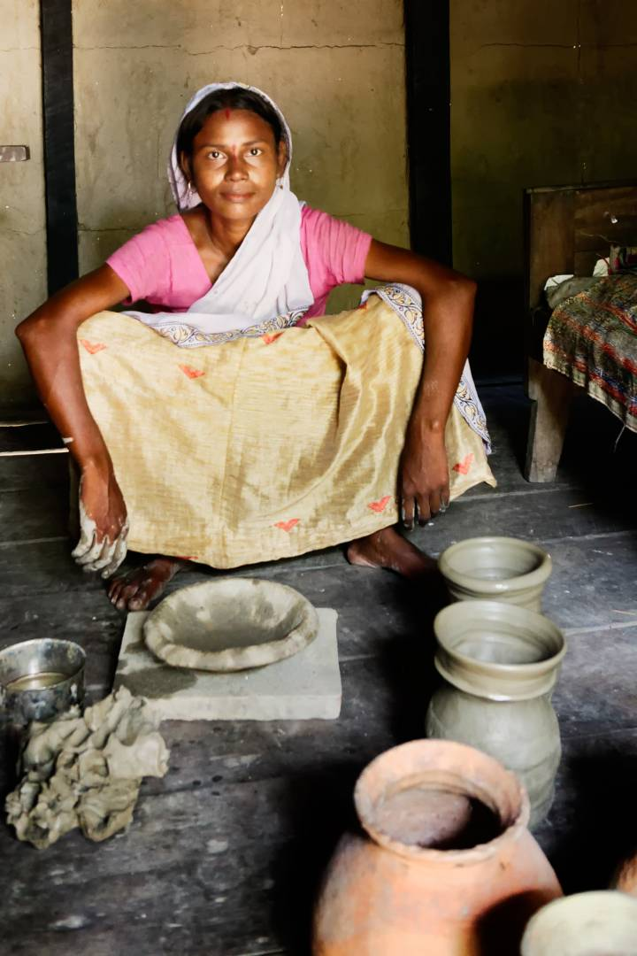 A potter in her hut in Salmora