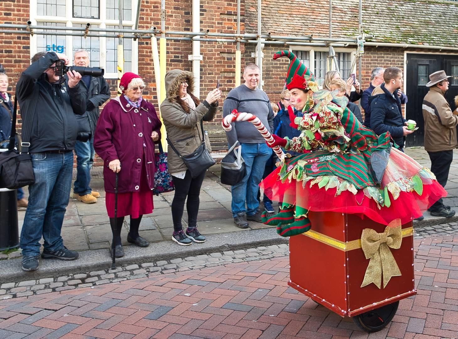 Santa's racing Elf – Christmas Dickens Elf racing on the high street, shot on Nikon Df and 24mm 1.8G