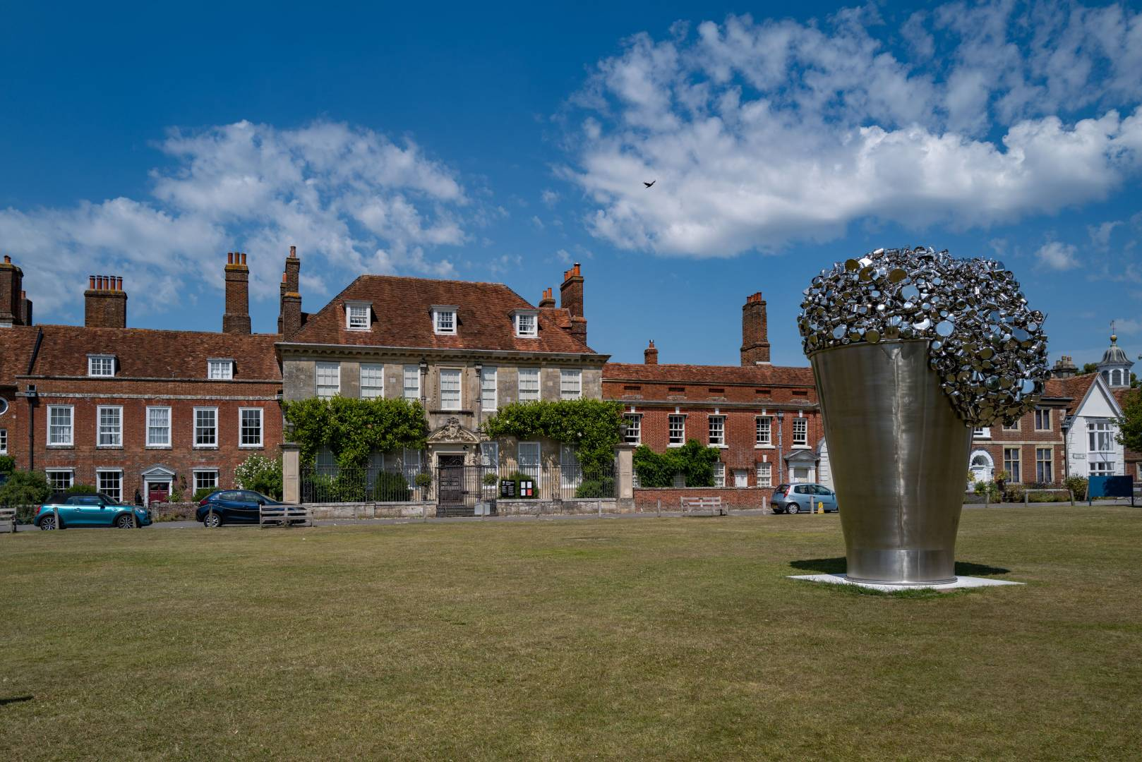 """A closer view of Mompesson House with Subodh Gupta's """"When Soak Becomes Spill"""" in the foreground."""