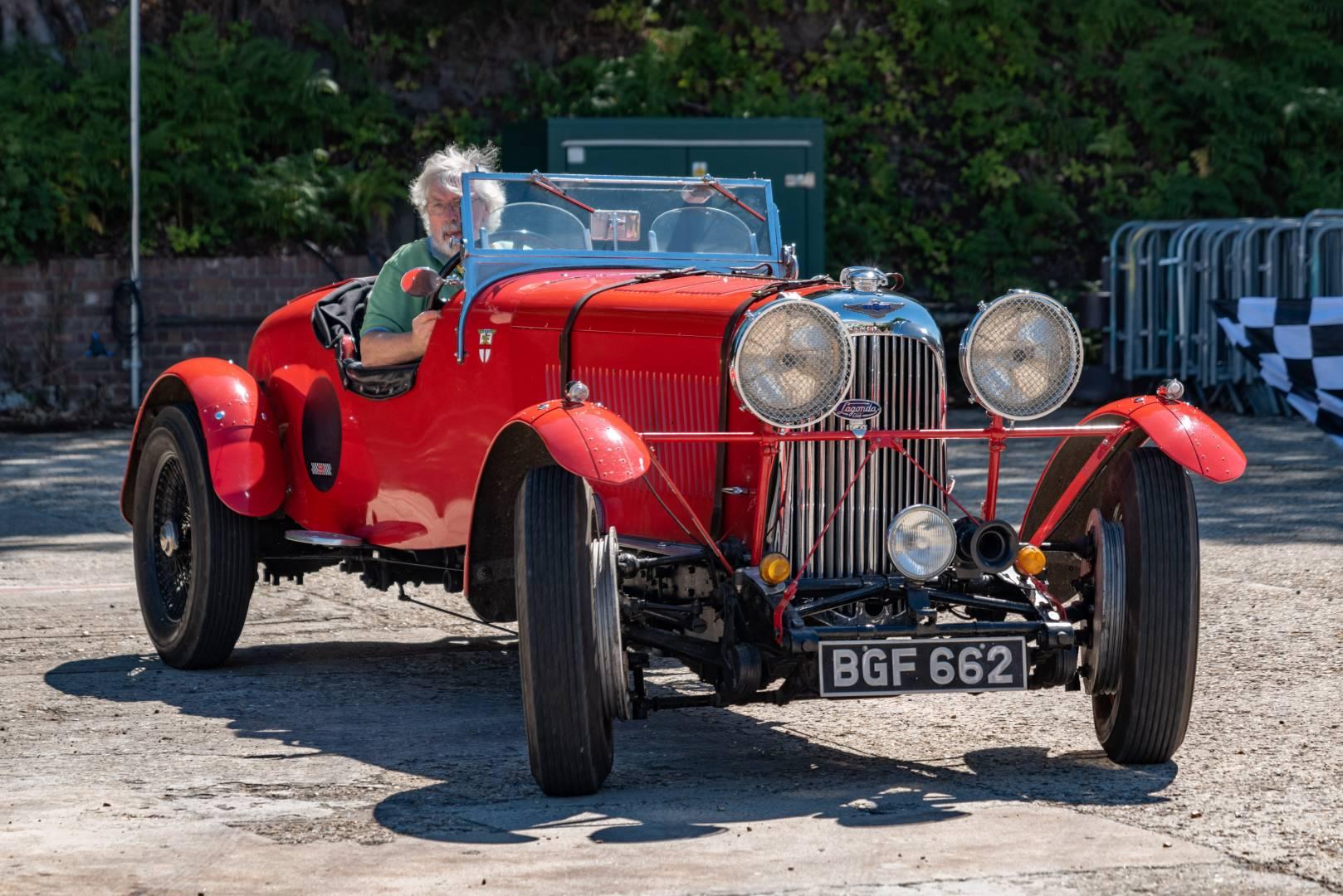 A beautiful prewar Lagonda is put through its faces on the finishing straight