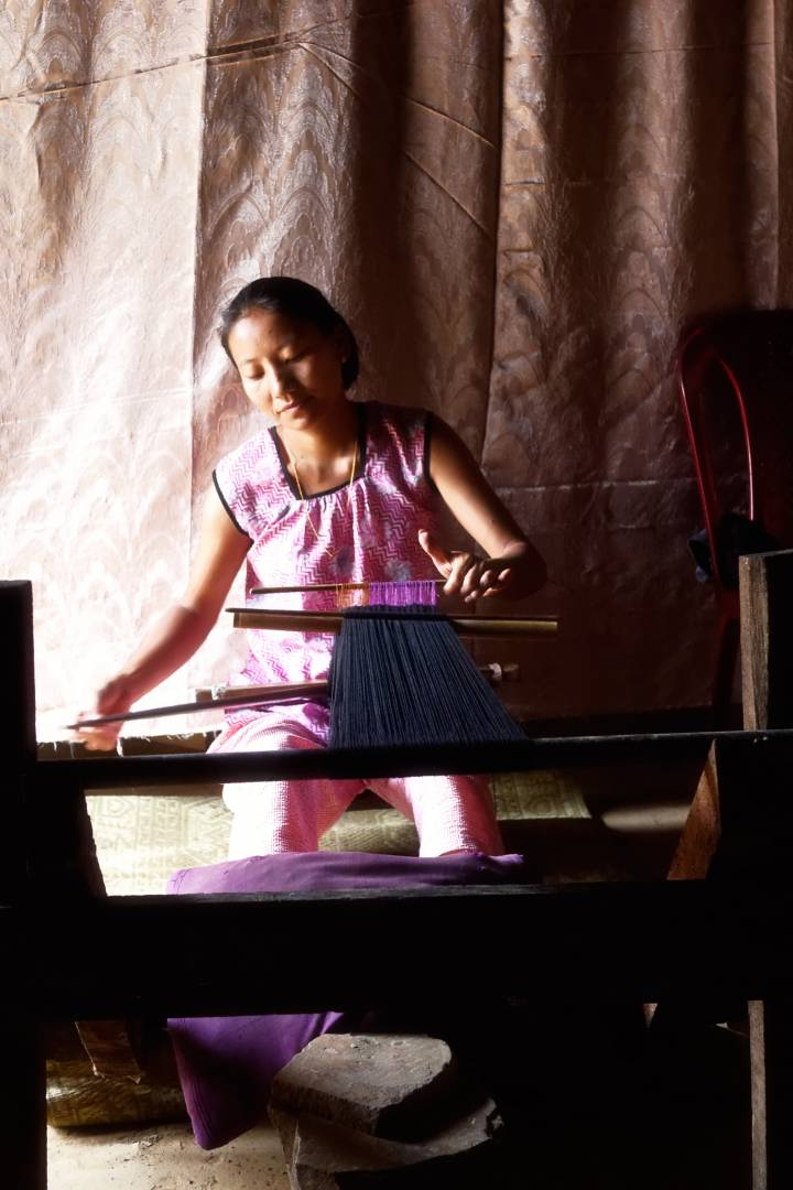 Chuile on her loom at home